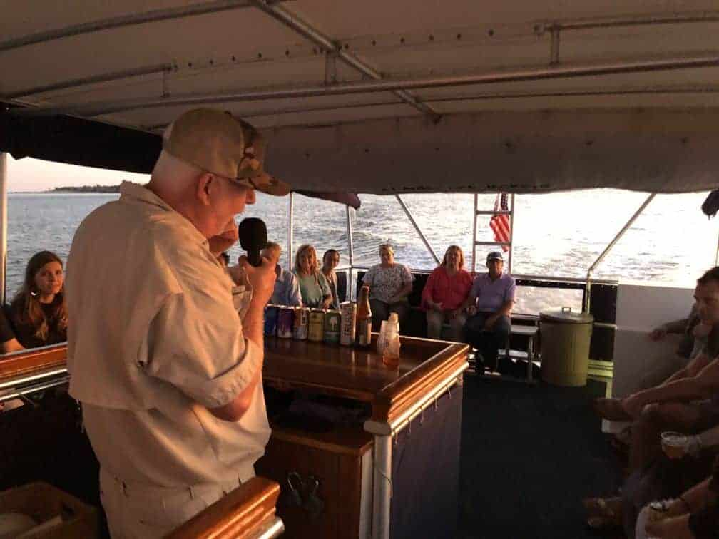 Speaker speaking to the group. Party boat rental Charleston, SC