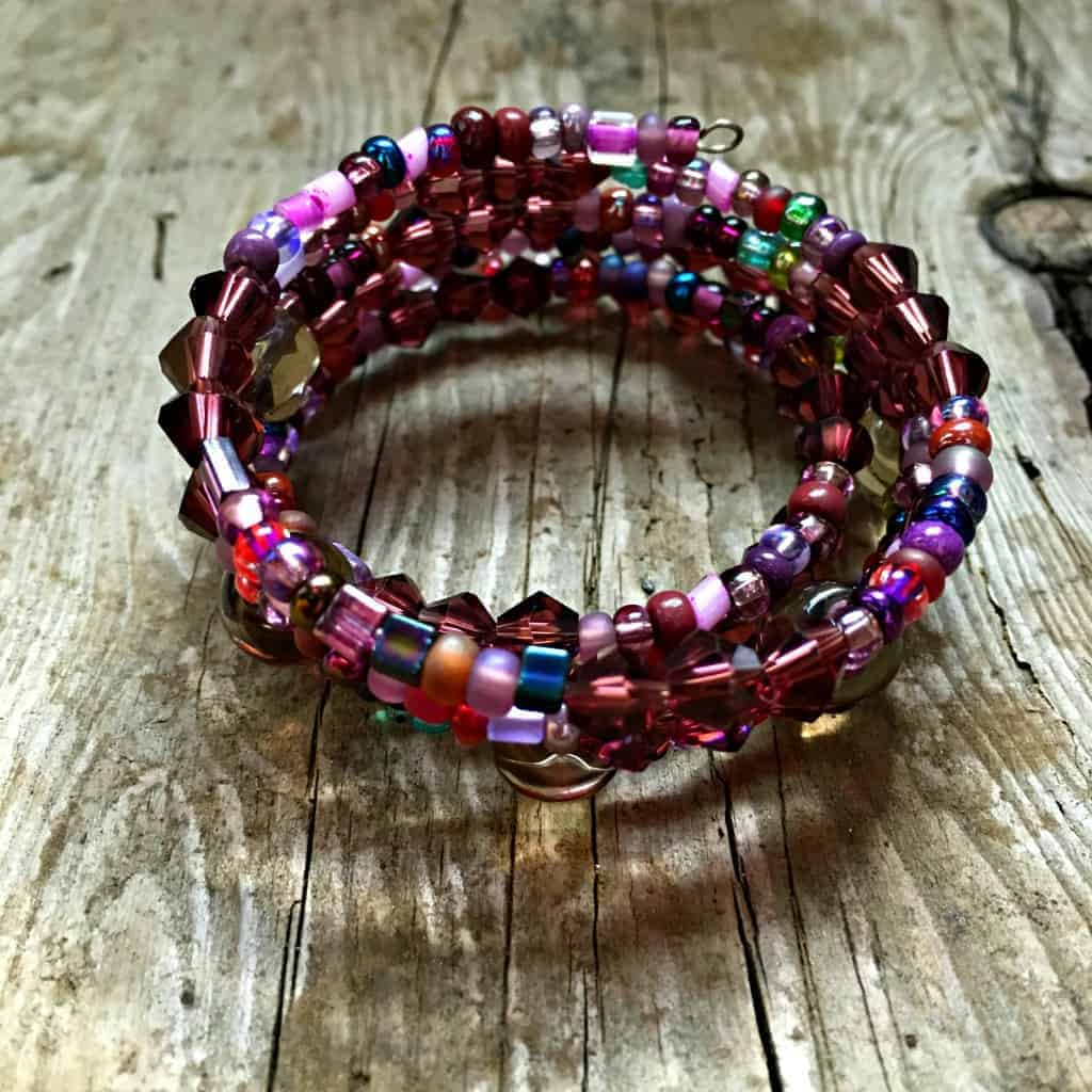 memory wire bracelet with pink and red beads