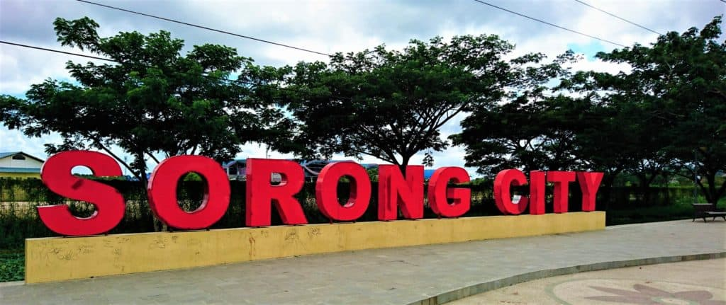 Red Sorong City sign in front of Domine Eduard Osok Airport