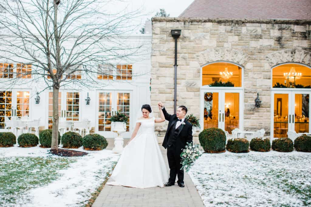wedding couple outside of wintery Haley Mention in Joliet IL
