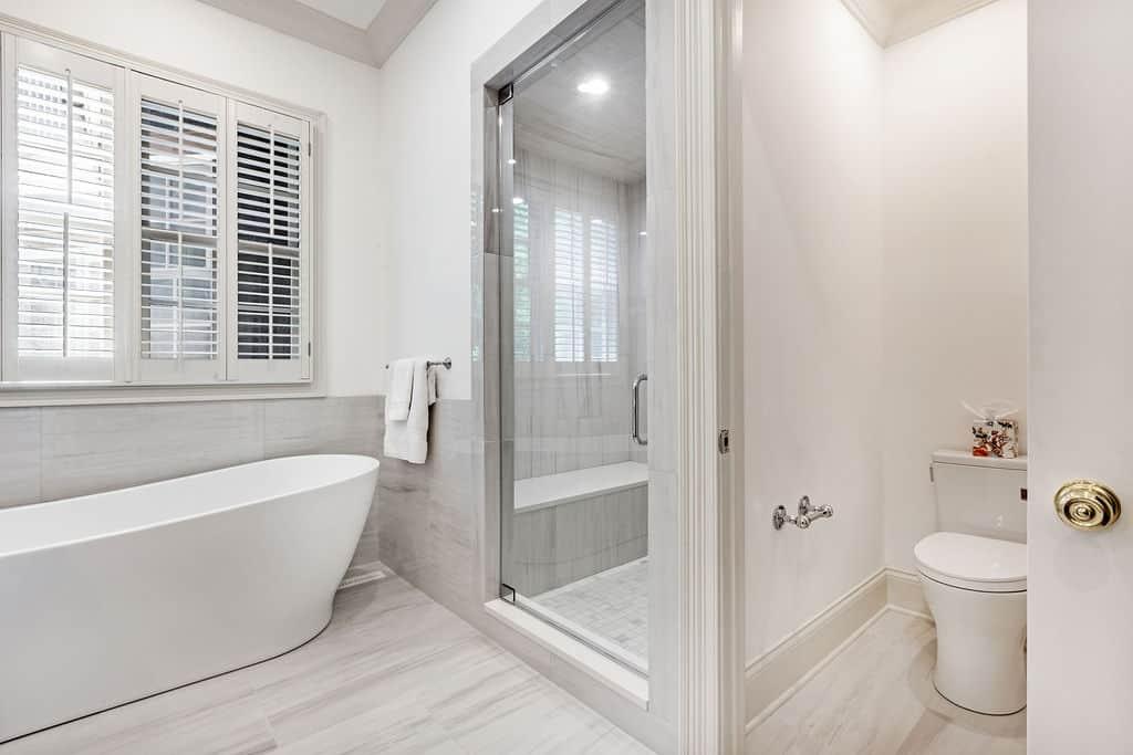 bathroom interior, bathtub, toilet, shower