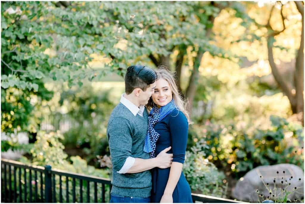 engaged couple hugging, she is looking away and he is looking at her, in Chicago Lincoln Park the best spot for engagement session shoot by bozena voytko