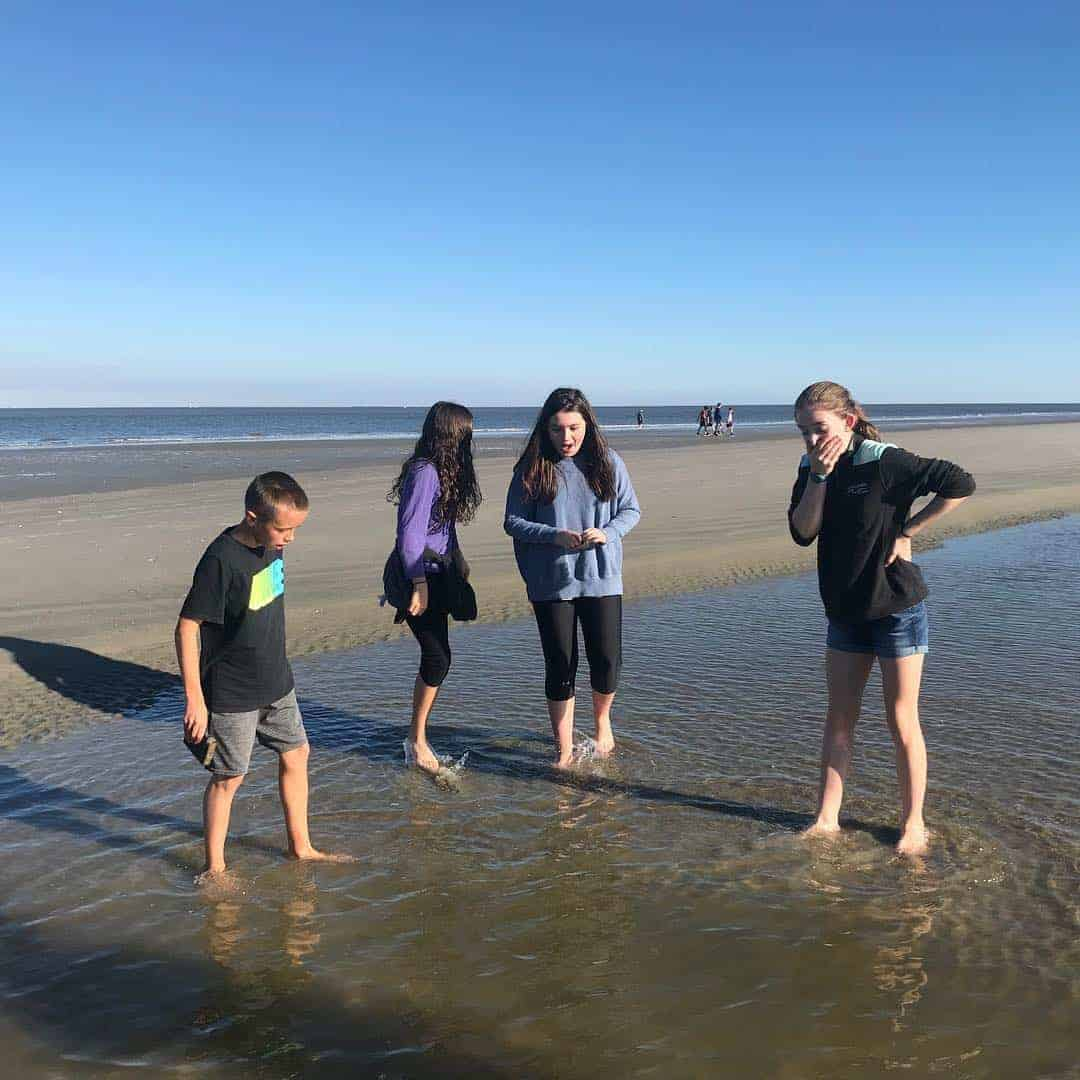Kids on the beach looking excitedly at something in the water. Nature boat tours Charleston