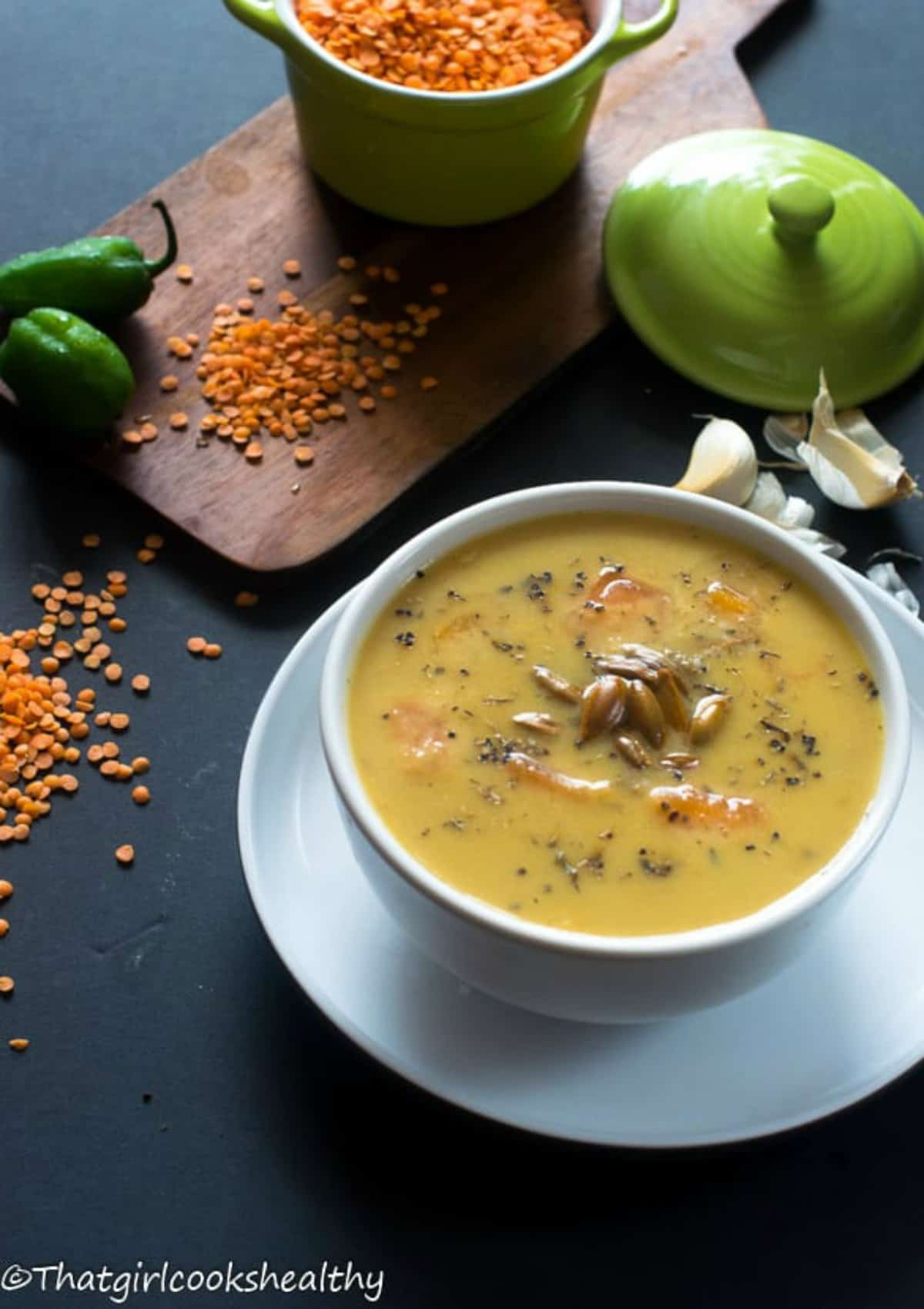 soup in a bowl with legumes around