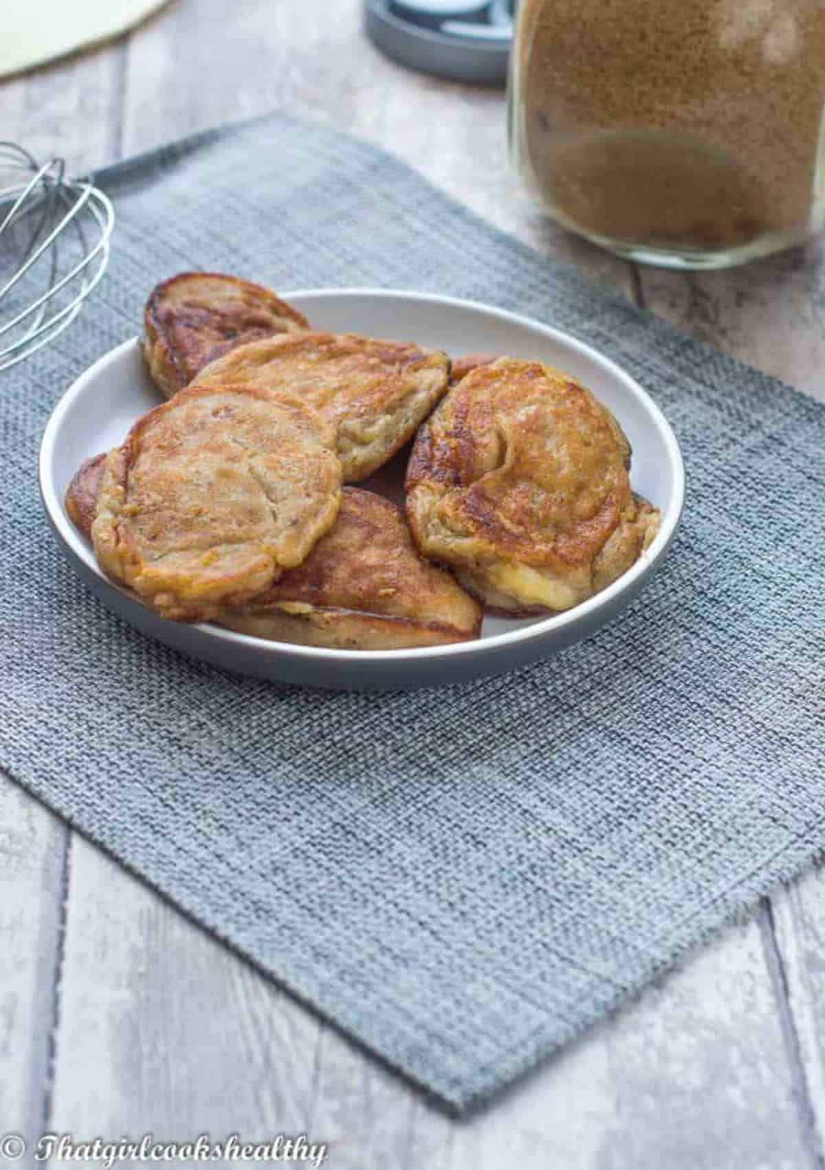 Fritters on a gray placemat