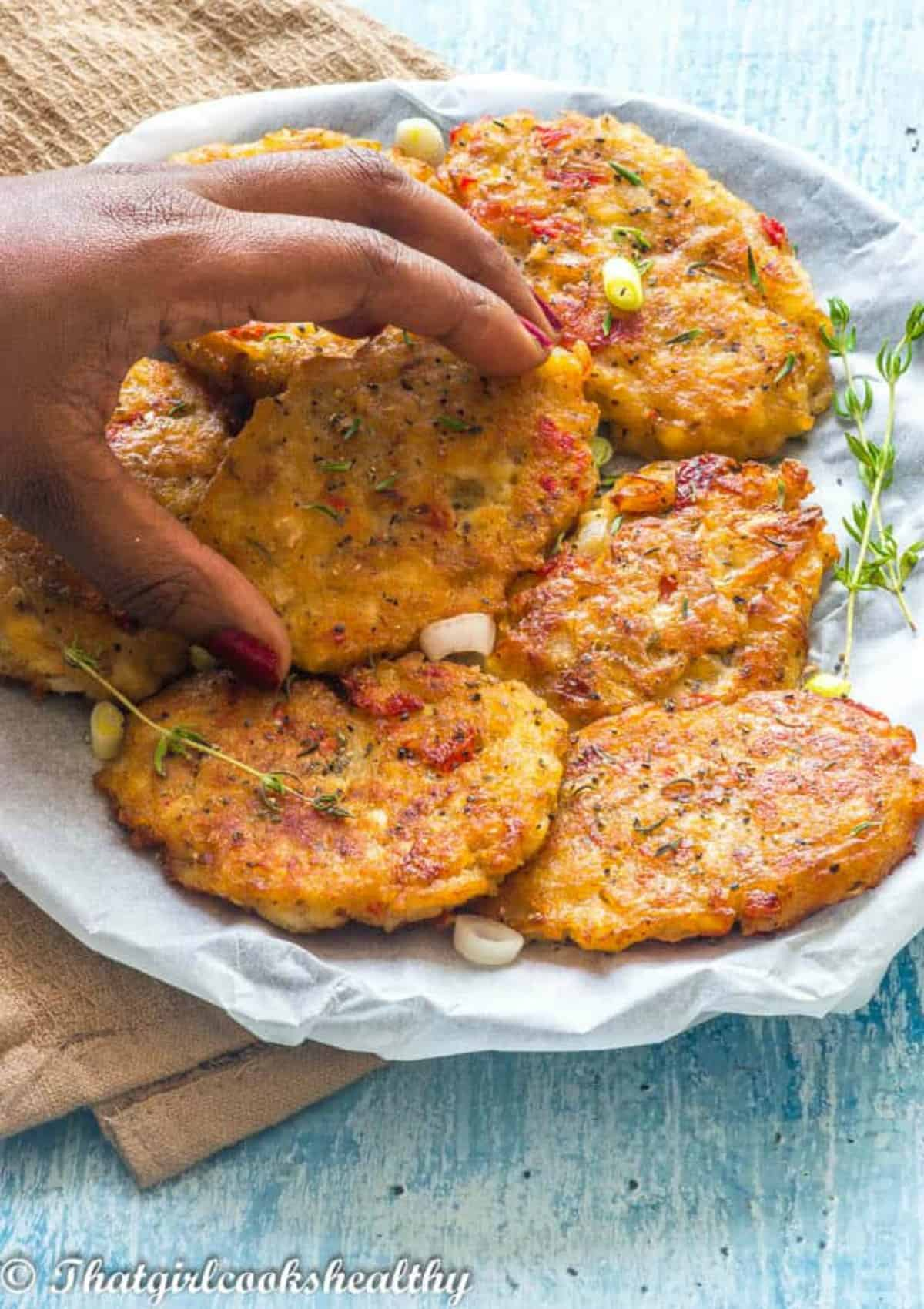 hand grabbing the fritters
