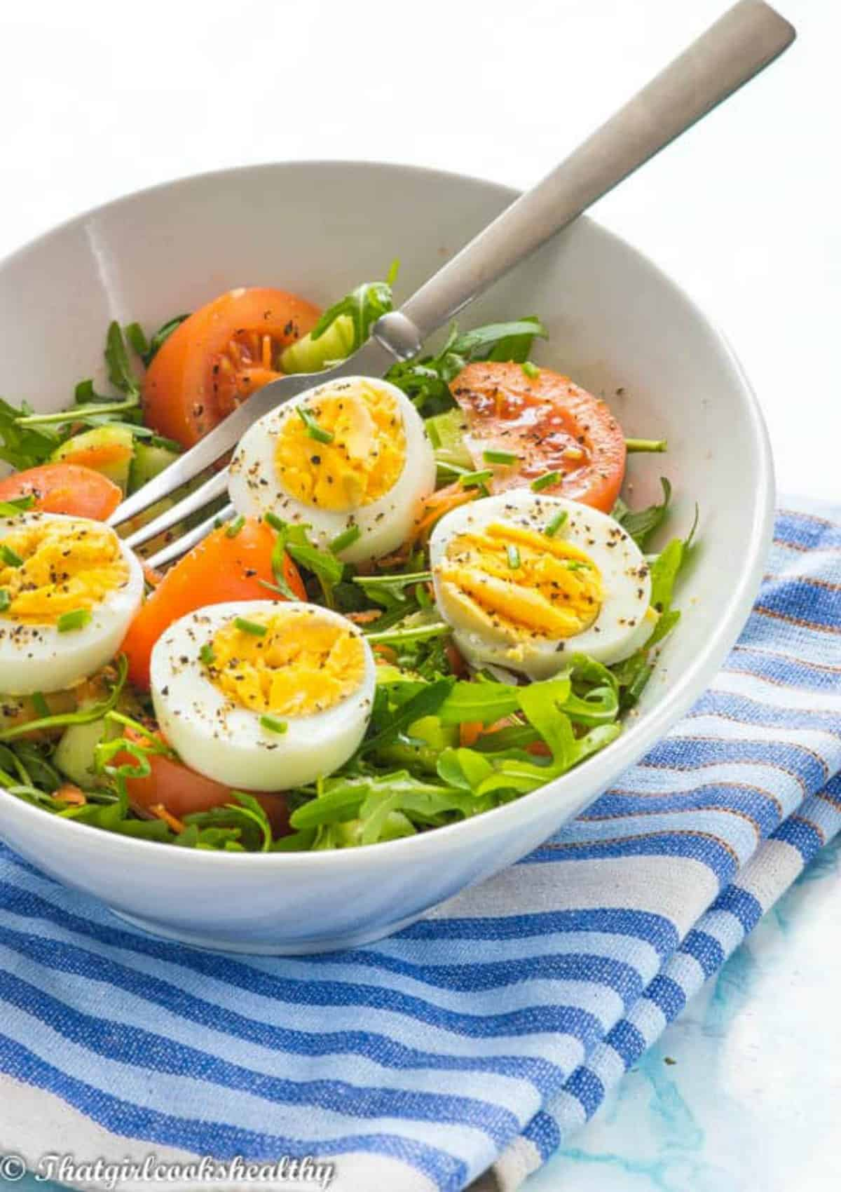 egg on a bed of salad