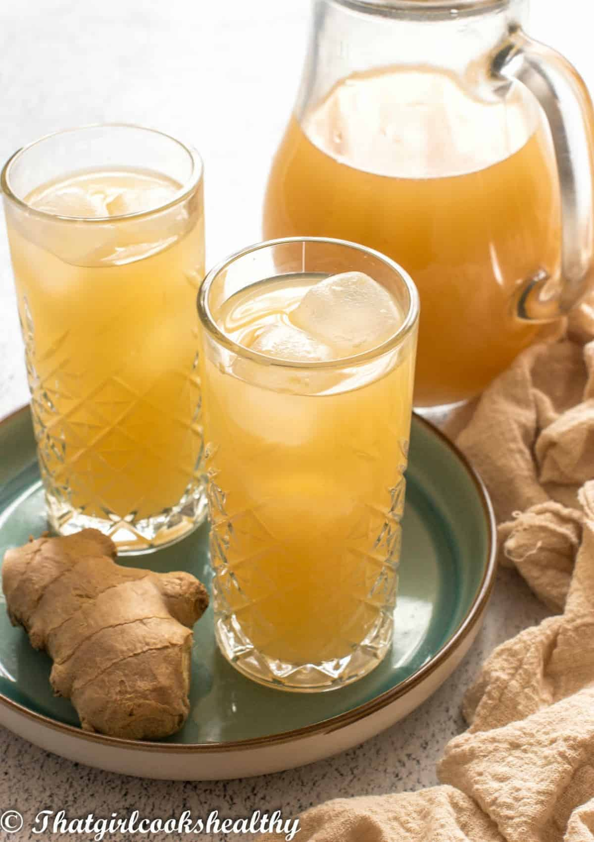 two glasses of ginger beer and jug