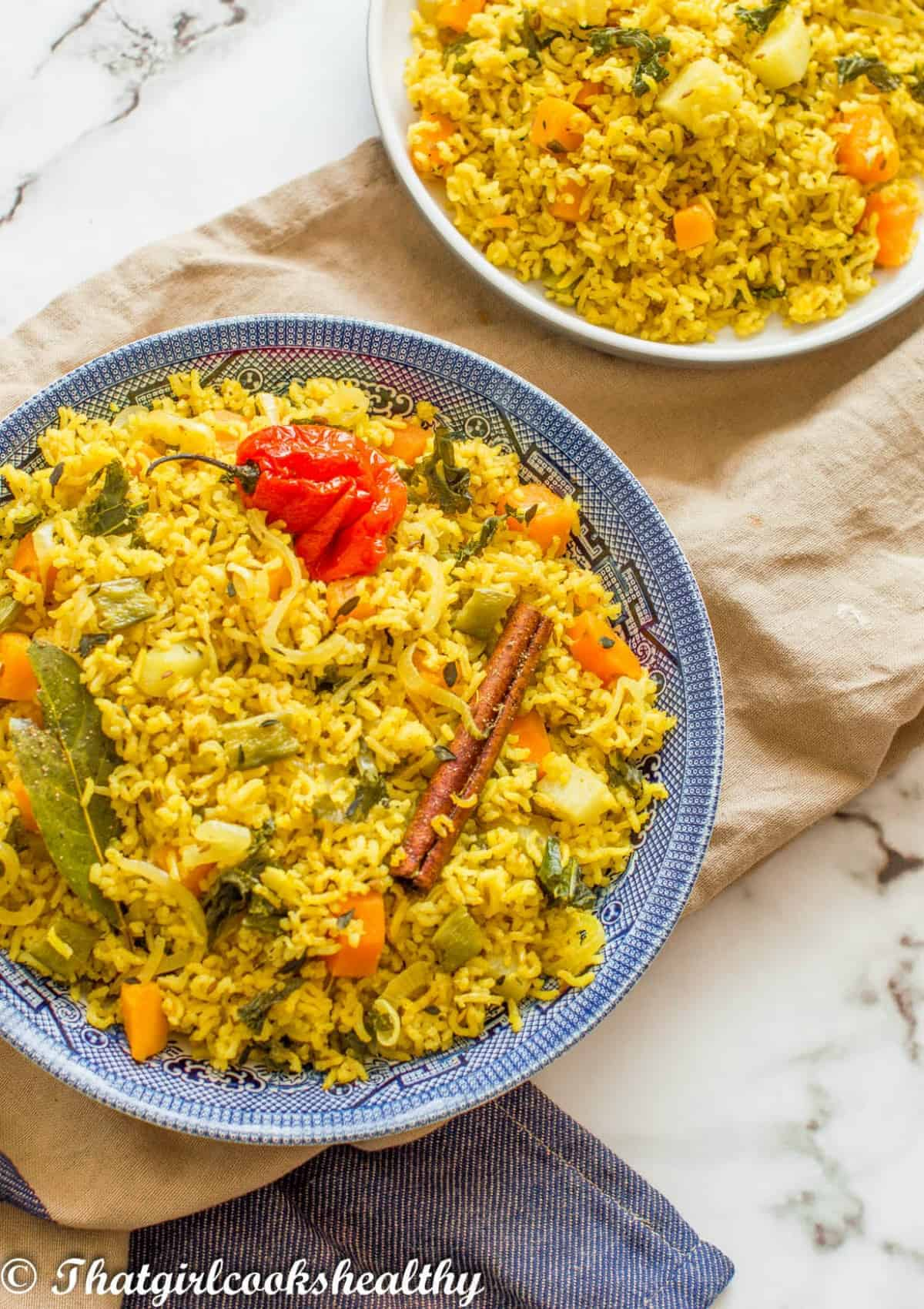 blue bowl with yellow rice