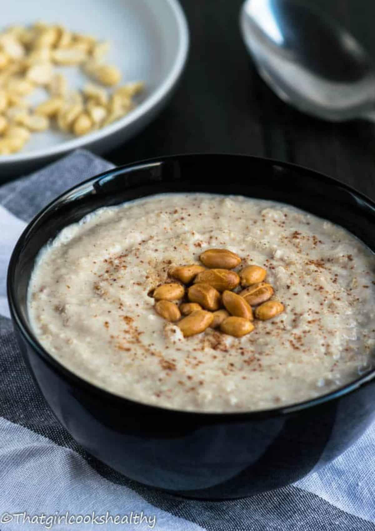 porridge with peanut garnish