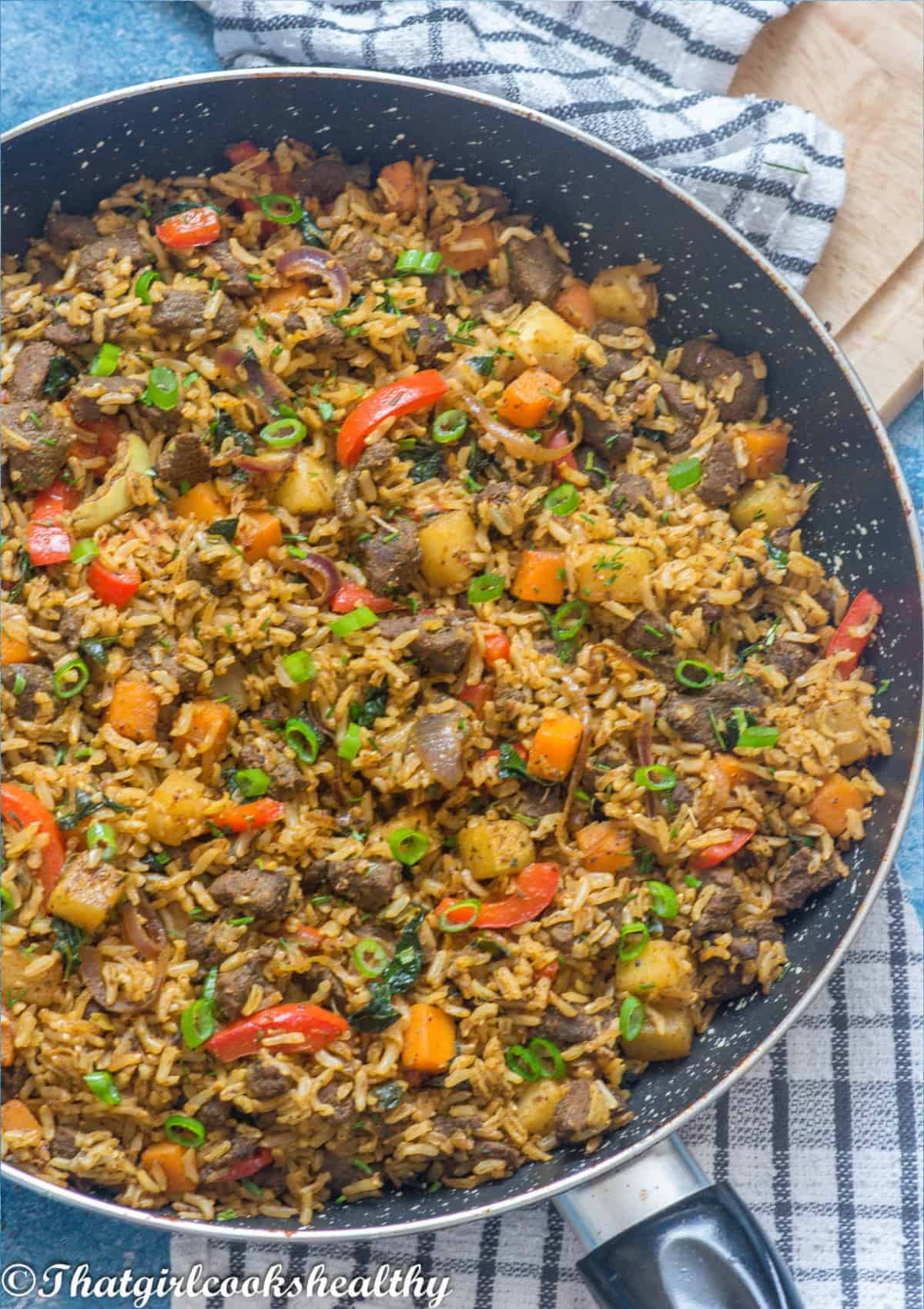 half a skillet with the lamb fried rice