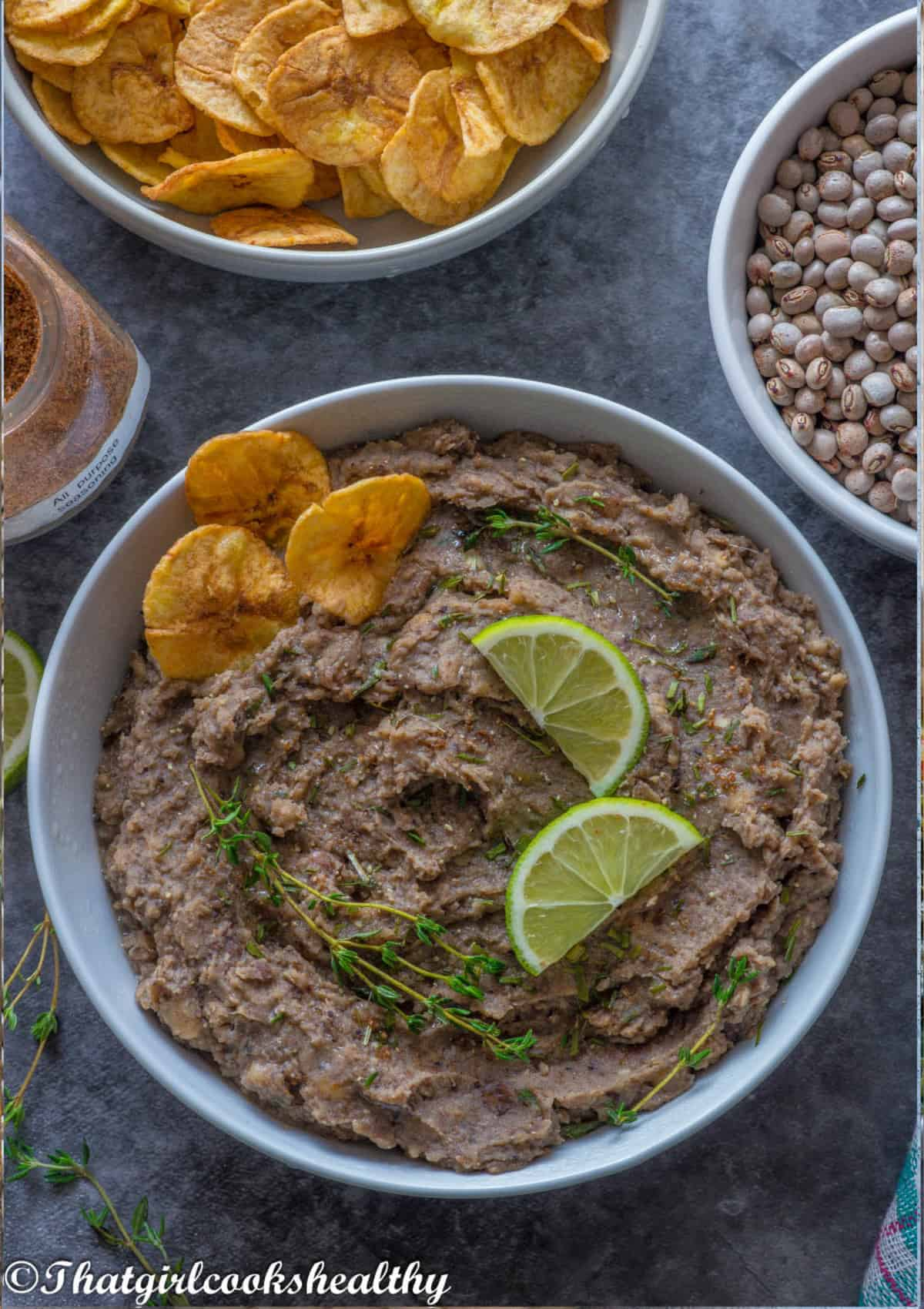 Refried gungo peas with garnish and plantain chips
