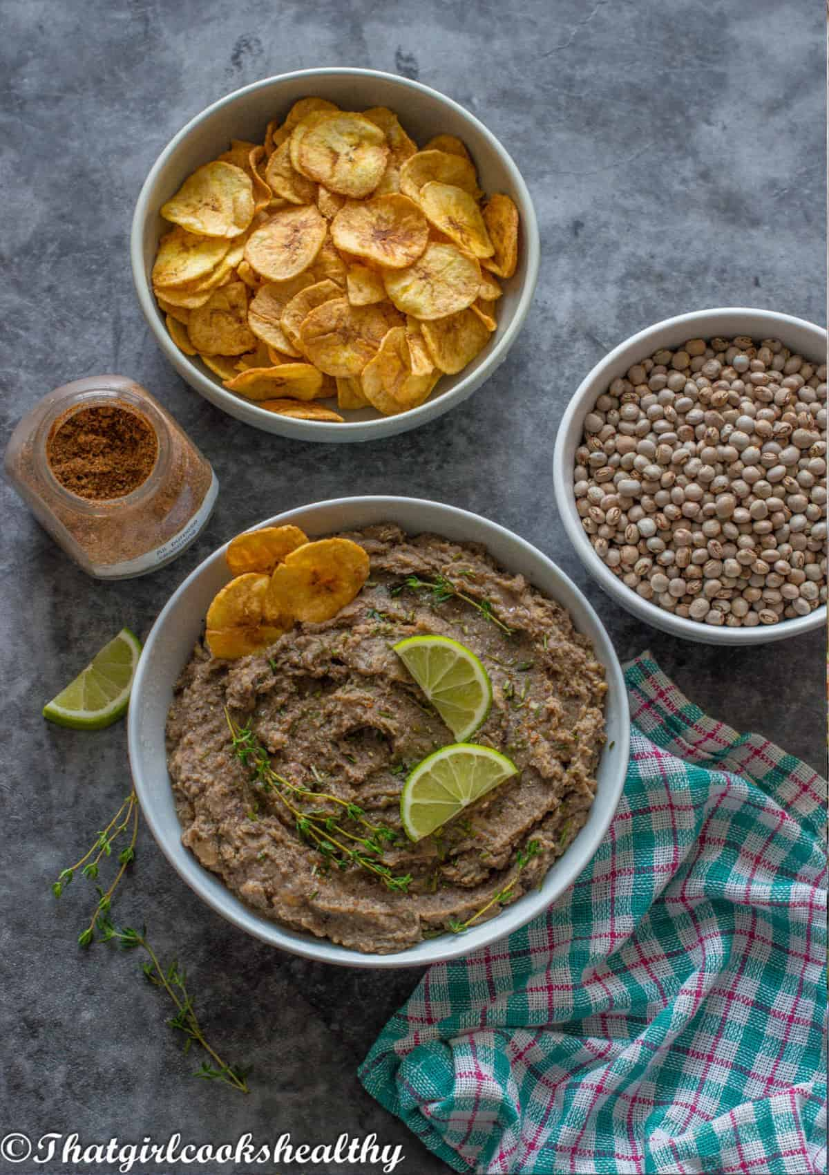 Refried beans, plantain chips and gungo peas all together