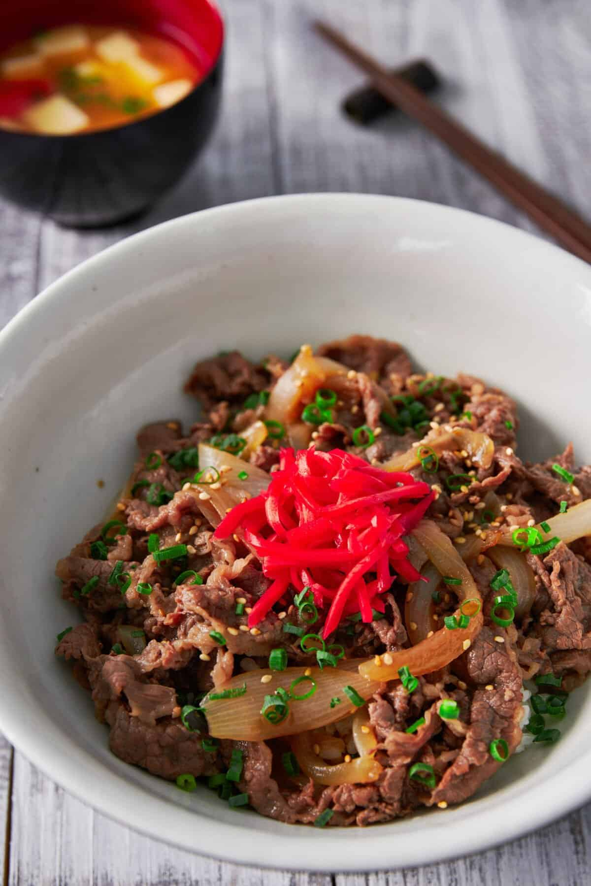 Gyudon (Beef and Bowl), is a classic Japanese dish made with beef and onions that have been simmered in a sweet and savory broth. Served over rice, this easy, satisfying meal comes together in under 15 minutes.