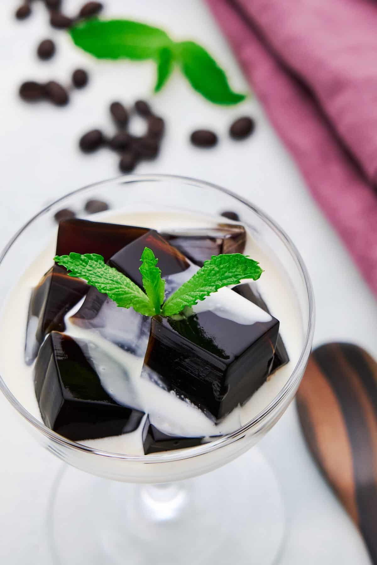With blocks of black coffee jelly served with cream and sweeteend condensed milk, this easy coffee dessert is mouthwateringly good.