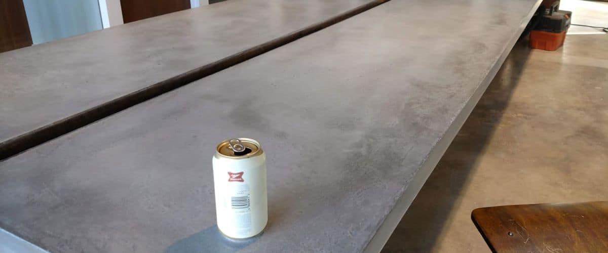 A cold beer on hand troweled concrete countertop