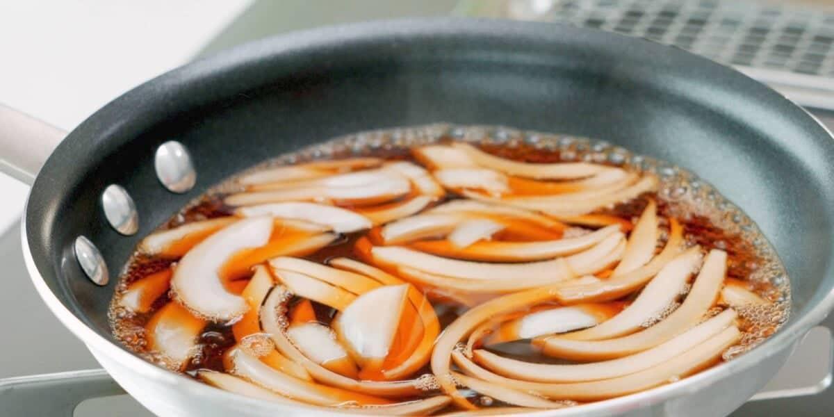 Onions simmering in dashi broth.