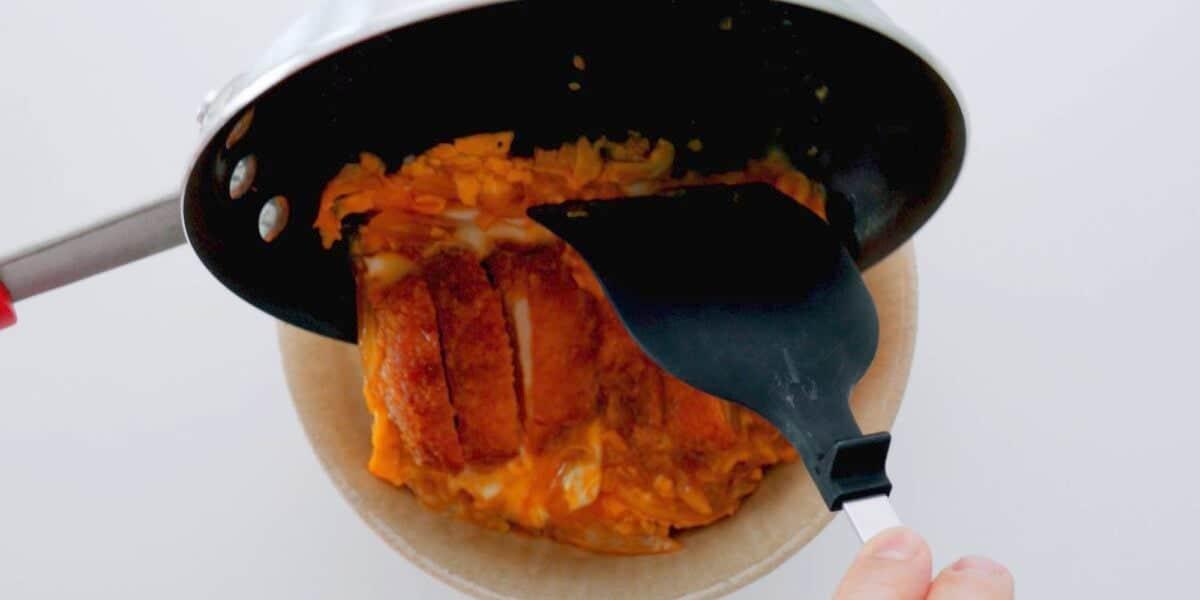 Sliding Katsu and egg over rice bowl.