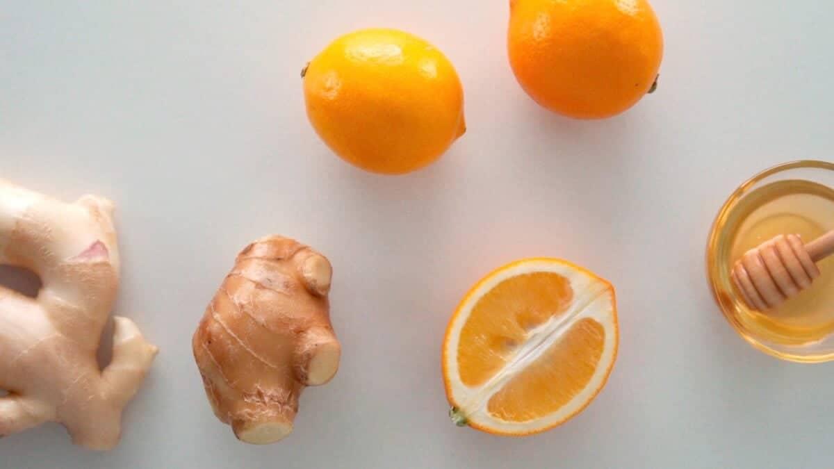 Ingredients for Ginger Tea including ginger,  Meyer Lemons, and honey.
