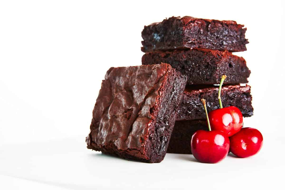 With a rich fudgy center and a crispy cakey top, this is the best chocolate cherry brownie recipe ever.