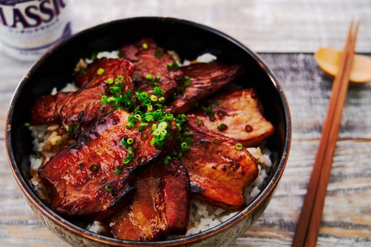 Tokachi Butadon is a grilled Japanese pork bowl glazed with caramelized soy sauce.