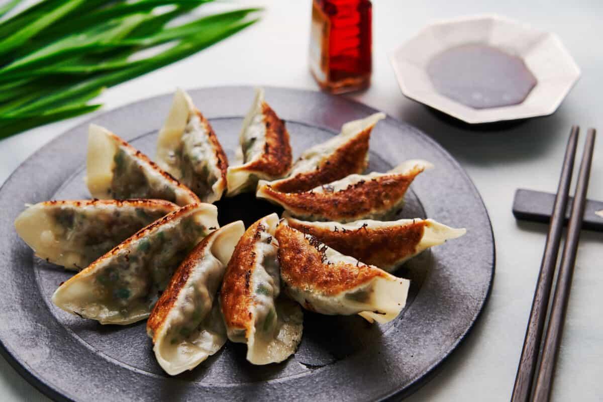 Crispy pan-fried vegetable Japanese dumplings with gyoza dipping sauce.