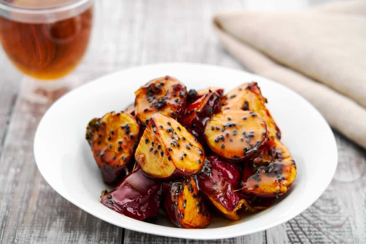"""Daigaku Imo, or """"college potatoes,"""" is a classic Japanese street food made with sweet potatoes glazed in sticky syrup and sesame seeds."""