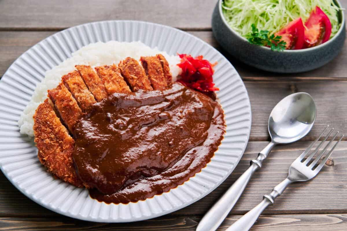 Katsu curry or cutlet curry is a classic Japanese comfort food made with a crispy pork cutlet sauced with rich Japanese curry sauce.