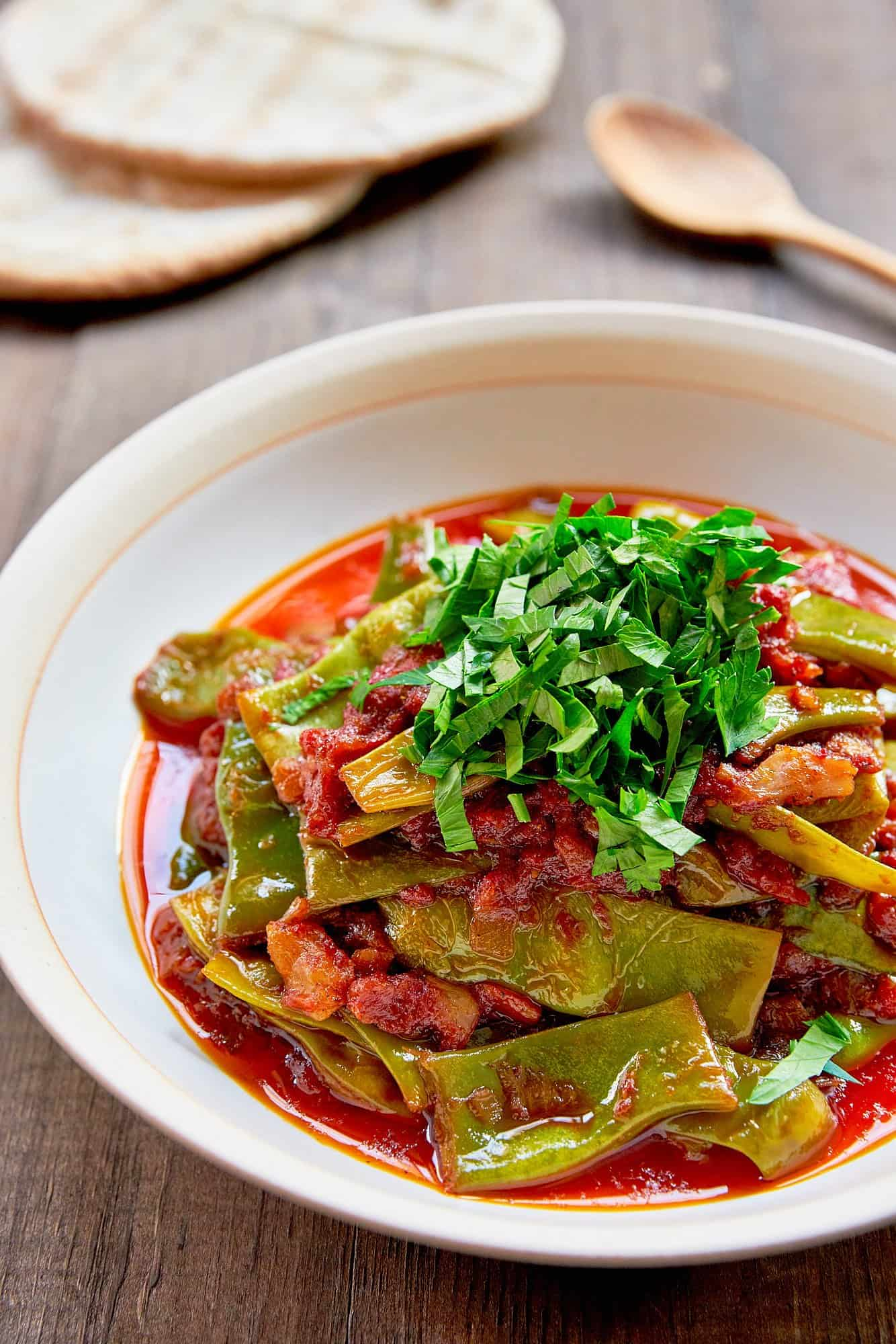 With green beans braised in olive oil, garlic and tomatoes until creamy and tender, Loubieh Bi Zeit is a delicious Lebanese meze that comes together from just a handful of ingredients.