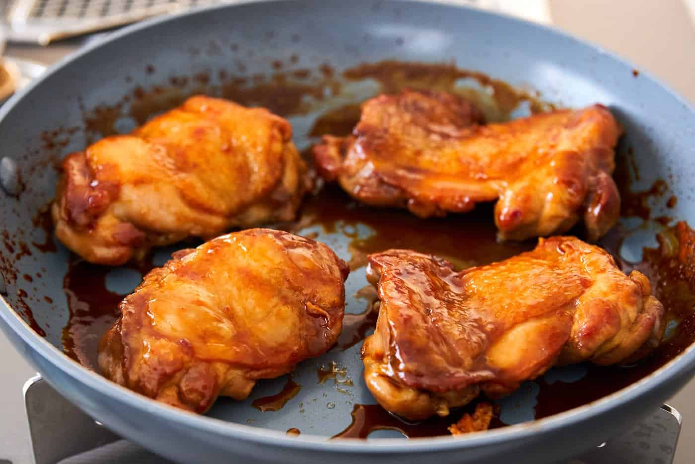 Authentic Chicken Teriyaki has just 4 ingredients and should result in glossy chicken glazed with sauce.