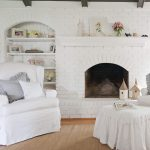 chic living room with white brick fireplace and wall