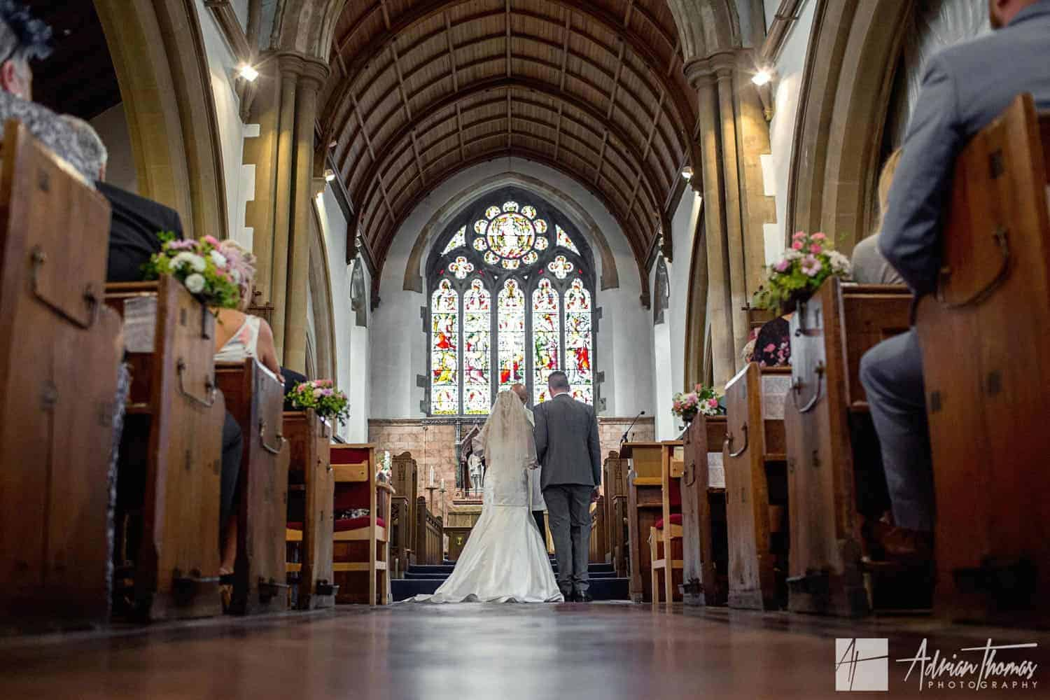 Image of bride and groom from the rear of St Martin's Church Caerphilly wedding.
