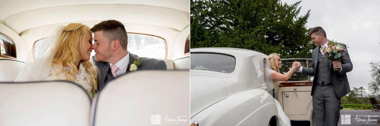 Bride and groom arriving in wedding car.