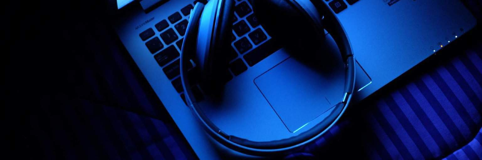 image of laptop and headphones