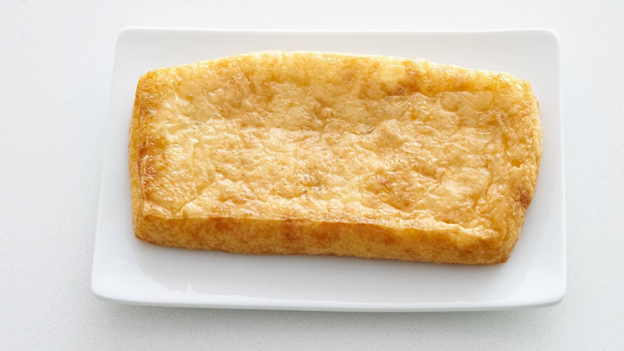The inari in kitsune udon is made using abura-age (fried tofu).