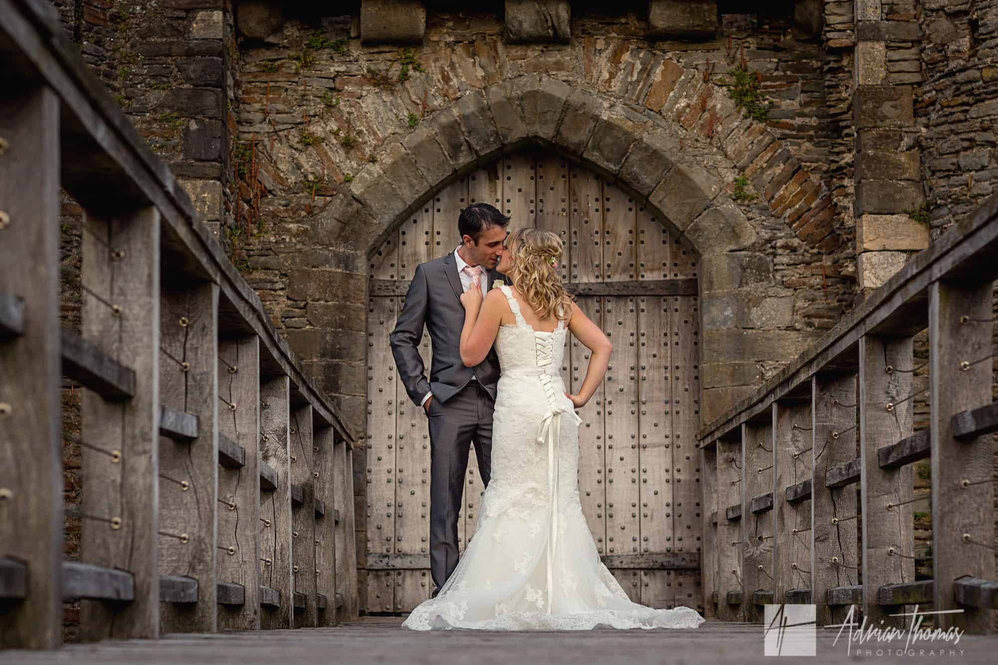 Bride and groom kissing during their Caerphilly Castle Wedding