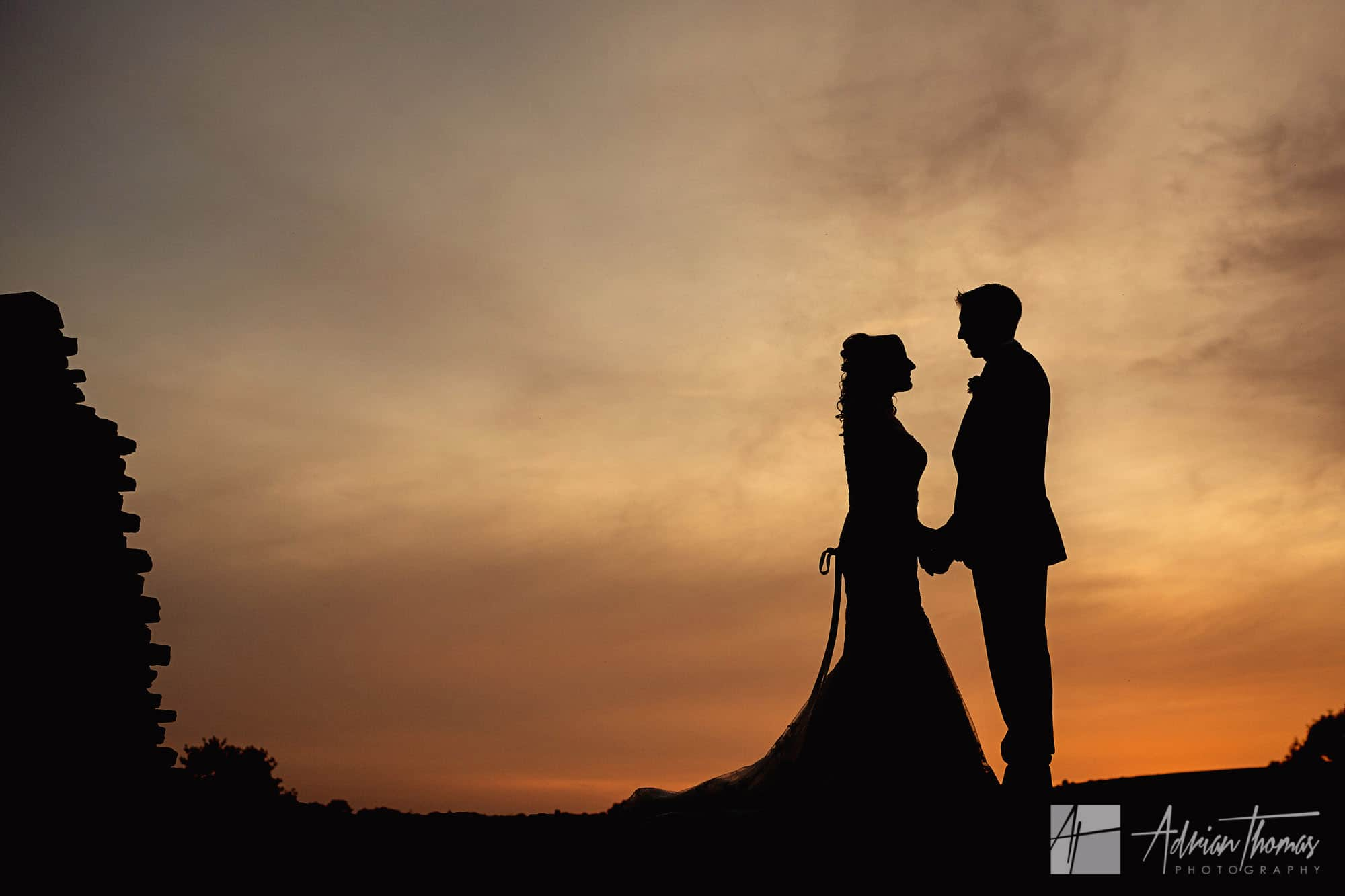 Silhouette image of newlywed couple at Caerphilly Castle Wedding
