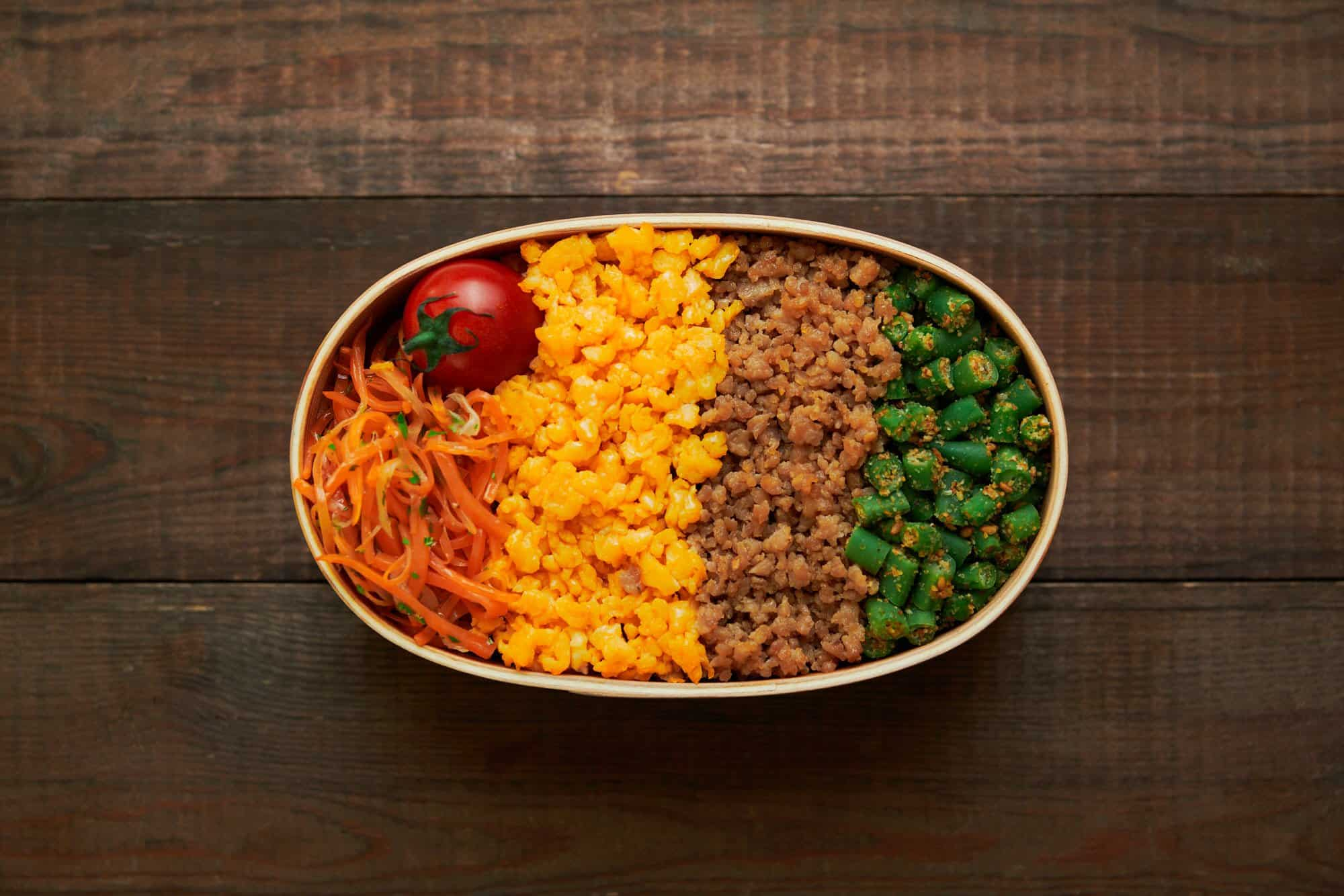 Soboro Don Bento is a rainbow of colors tastes and textures in a portable bento box lunch.
