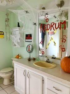 redrum and bloody prints on bathroom mirror