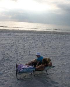 flying with baby, flying with an infant, family on beach, enjoying madeira beach, madeira beach florida, florida
