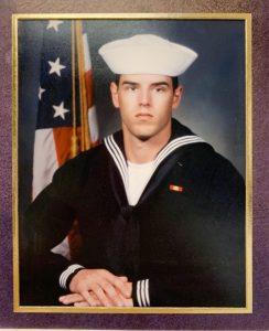 portrait of man in navy uniform