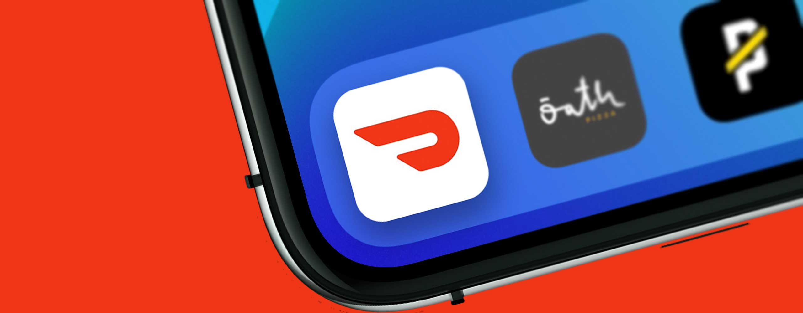 DoorDash app icon on tilted iPhone screen