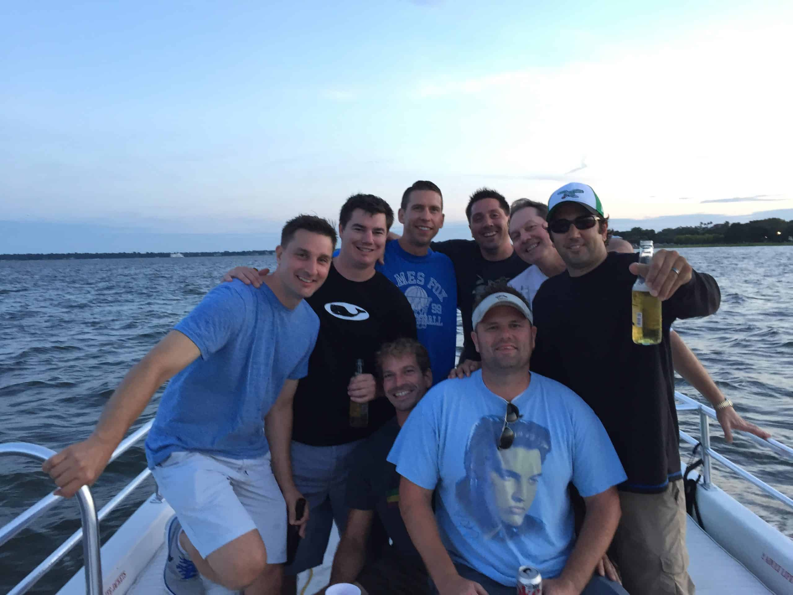 Group of men gathered on the boat. Bachelor and bachelorette boat cruises