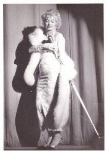 Burlesque dancer Dixie Evans performs