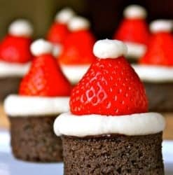 Santa hat brownies -- 25 Amazing Christmas Party Appetizer Recipes! Fun Food Ideas and more for a Holiday Party. LivingLocurto.com