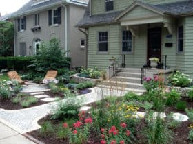try the idea to pair concrete steps with ornamental perennial for a beautiful front exterior design