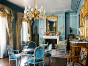 ornate blue furniture and antique gold chandeliers in your living room for history lovers