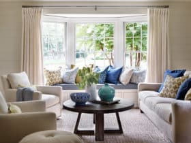 complete an elegant formal living room with bay window seating and multicolored pillows
