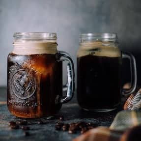 Two jars of cold brew coffee with ice