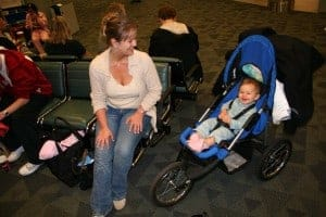 baby in stroller, airport gate, flying with an infant